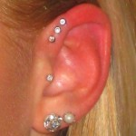 triple helix Pierced by Eric at Living Canvas Tattoo